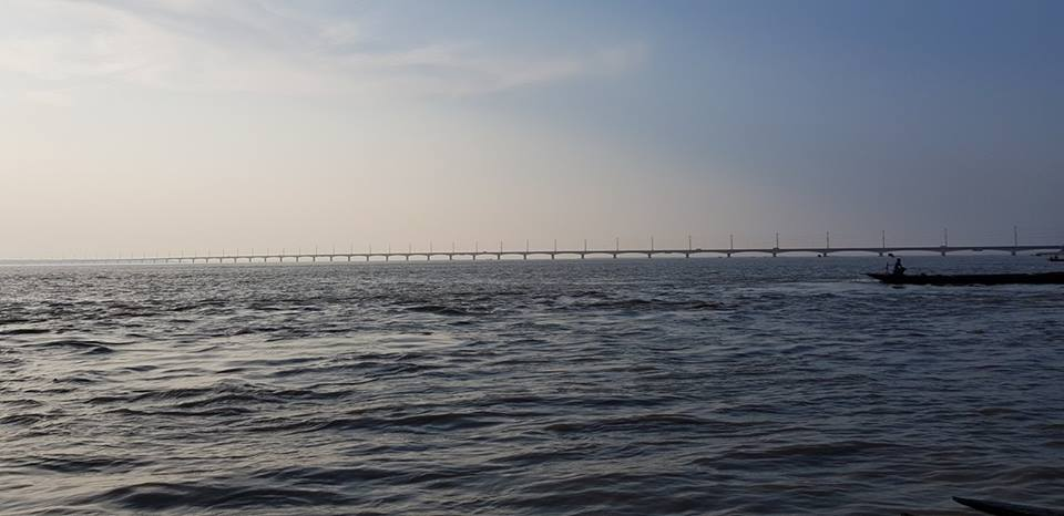 Seeing the Jamuna Bridge from a distance and traveling by a trawler on the river Jamuna.